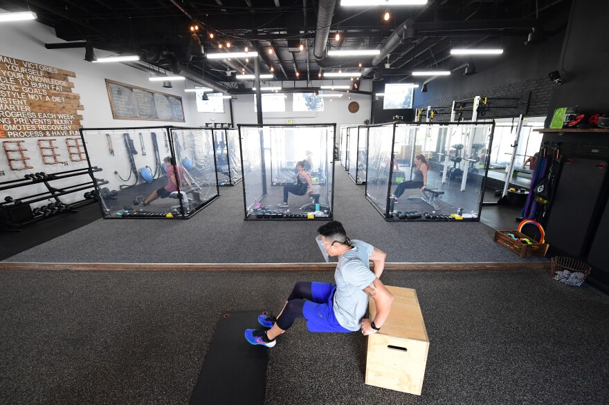 A workout class at Inspire South Bay Fitness in Redondo Beach, Calif., restricted students to plastic pods in June.
