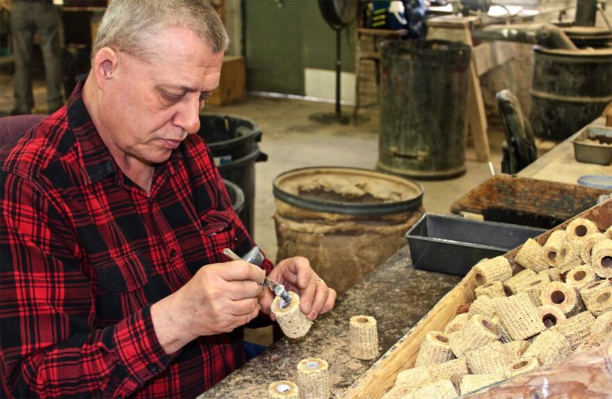 David Reisenleiter works on the bowls of corn cob pipes at the Missouri Meerschaum Company in Washington, Missouri.