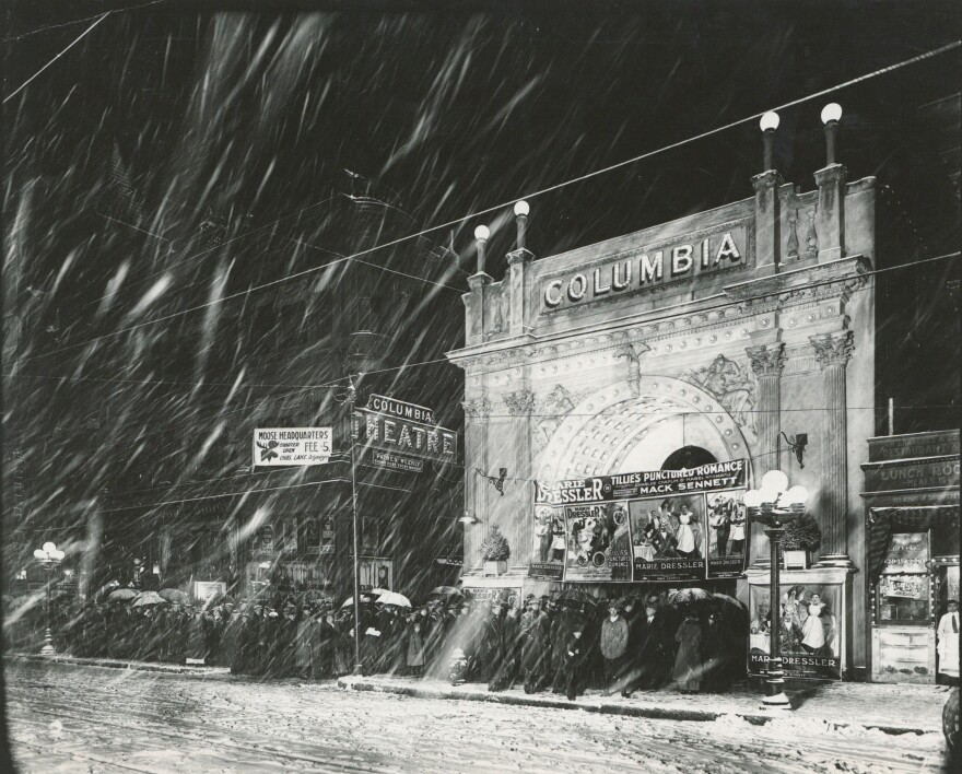 William Preston Mayfield's photograph of the Columbia Theater during snow storm, 1914.