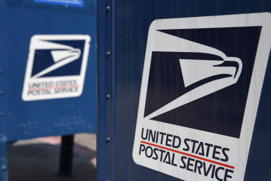 The United States Postal Service logo is seen on a mailbox outside a post office in Los Angeles, California.