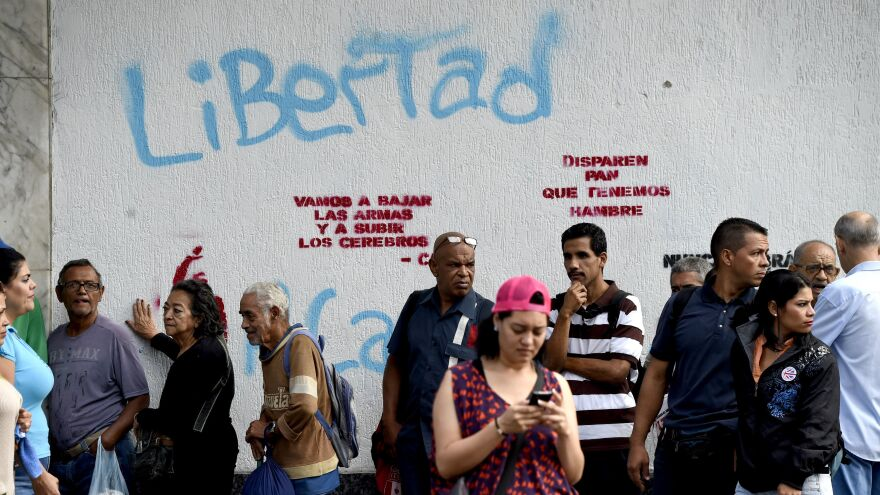 Commuters in Caracas wait for public transport during the strike.