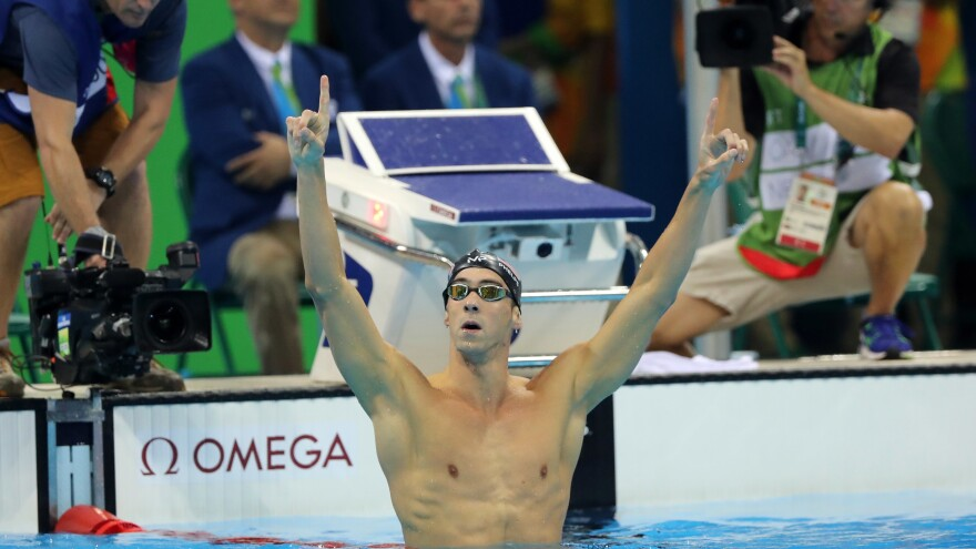 Michael Phelps celebrates winning the gold medal in the 200-meter butterfly on Tuesday night. In taking his 20th Olympic gold, Phelps also avenged a narrow loss in the event in 2012 to South Africa's Chad le Clos, who finished fourth.