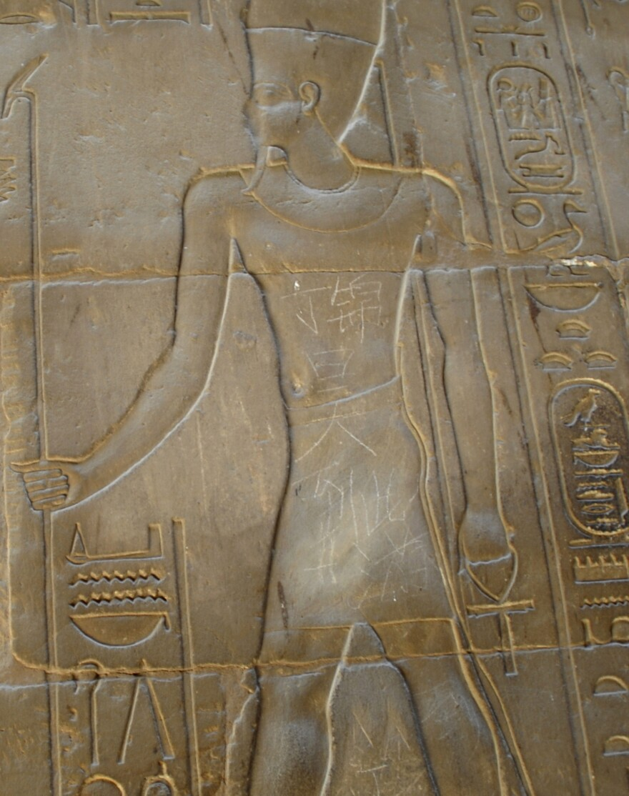 """Chinese characters that read """"Ding Jinhao was here"""" are seen on the torso of a figure on the wall of a 3,500-year-old temple in Luxor, Egypt, in 2013. A 15-year-old Chinese boy scratched the characters onto the wall of the ancient site."""