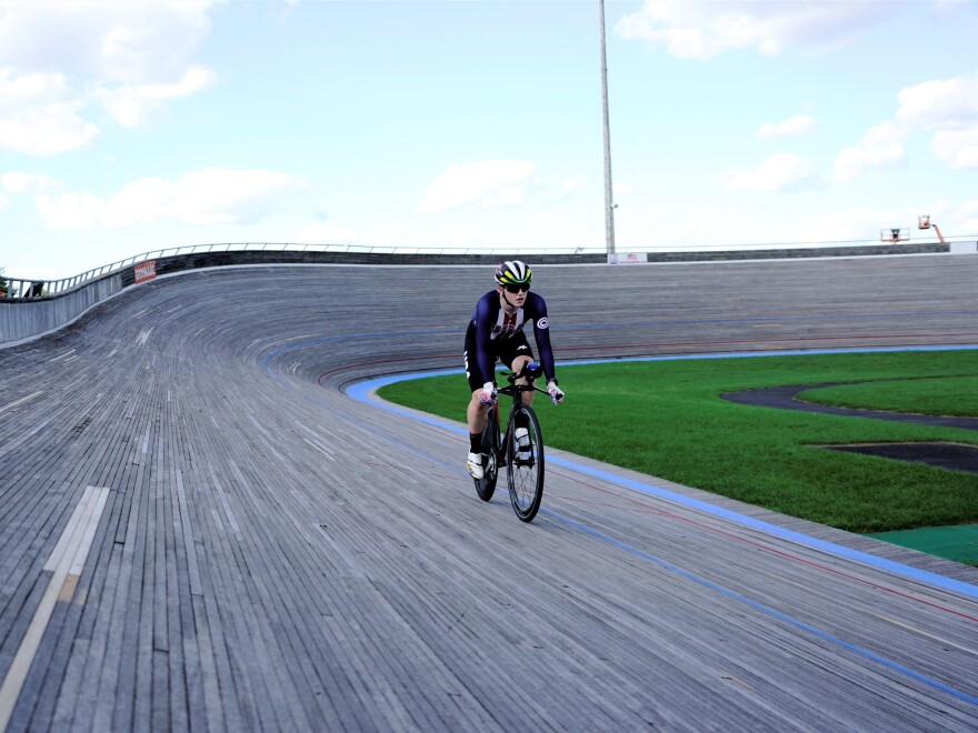 Catlin cycling on a track.