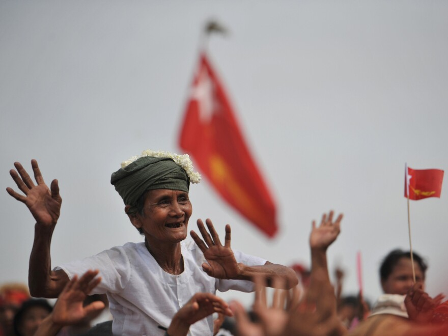 A supporter cheers on Aung San Suu Kyi, Myanmar opposition leader, as she visits her constituency during new year festivities in Kawhmu outside Yangon on April 17.
