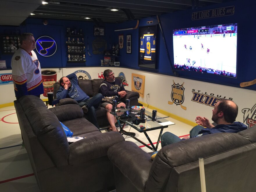 Dennis Minner and friends gather to watch a recent Blues game in this basement that has been converted into a mini-Scottrade Center. March 2018