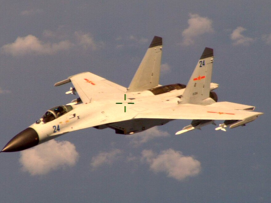 """This handout photo provided by the Office of the Defense Secretary (OSD), taken Aug. 19, 2014, shows a Chinese fighter jet that the White House said Friday conducted a """"dangerous intercept"""" of a U.S. Navy surveillance and reconnaissance aircraft."""