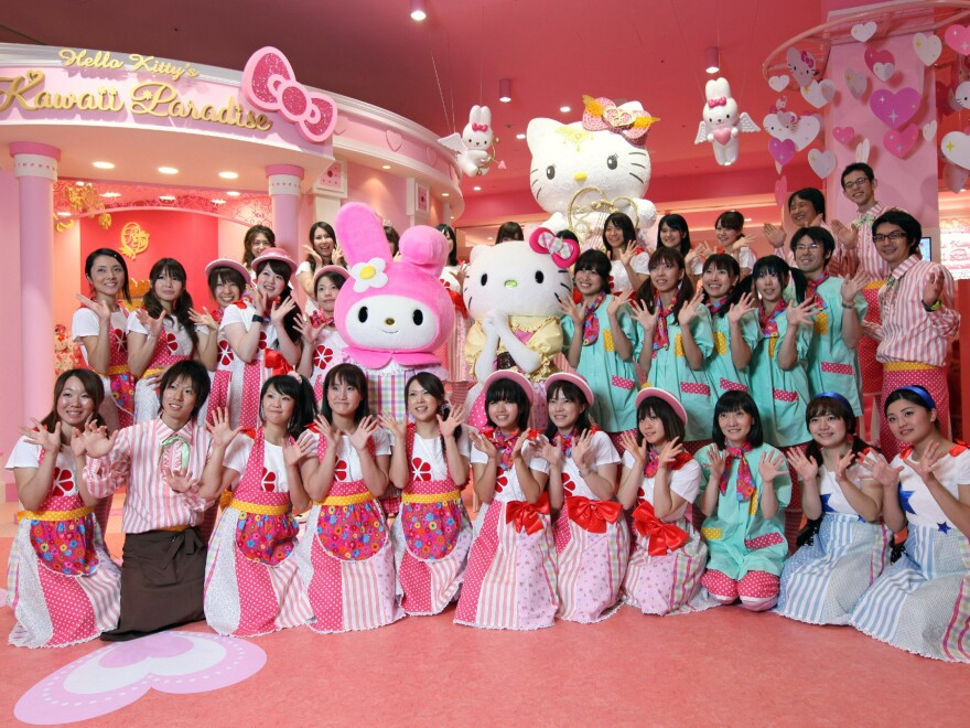 Staff at Tokyo's Hello Kitty Kawaii Paradise theme park pose for photos at a preview in a shopping mall in 2010.