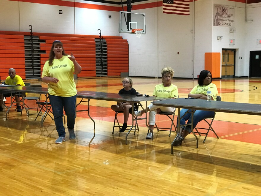 (left to right) Tina Stride, Jasmine (Lisa's granddaughter), Lisa Melcher, and Tara Mayson - the women behind the Hope Dealer Project - speaking to guests at their second annual Community United in Recovery event held at Martinsburg High School.