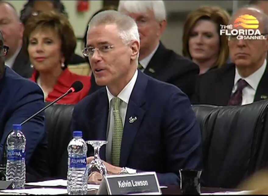 Steven Currall was approved as the next USF System president by the Florida Board of Governors Thursday. USF Board Chair Brian Lamb, left, was named to the Board of Governors as well.