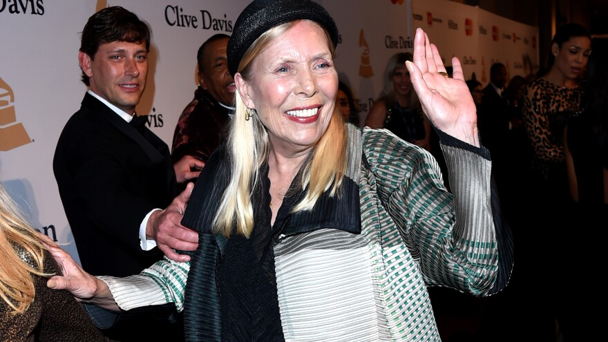 Musician Joni Mitchell attends a party before the Grammy Awards in February. Mitchell, 71, was found unconscious in her home Tuesday.