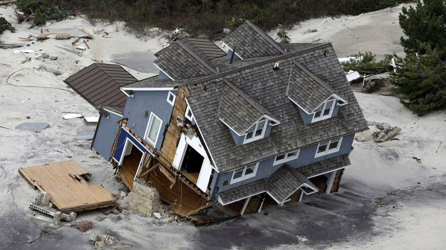 "A house on the central Jersey Shore coast collapsed after Superstorm Sandy hit in 2012. Richard Ford said he focused on houses in the wake of the storm in his new book, <em>Let Me Be Frank With You,</em> because they have an ""almost iconic status."" ""A house is where you look out the window and see the world,"" he says."