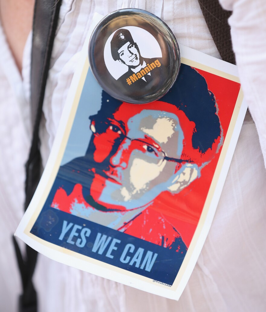 An activist wears pictures of leakers Edward Snowden and Bradley Manning during a demonstration against the electonic surveillance tactics of the NSA, in Berlin on Saturday.