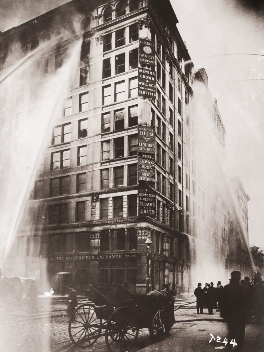<strong>In Flames: </strong>Firefighters spray water on the upper floors of the Asch Building, which housed the Triangle Shirtwaist Company. Many workers died after jumping from the 10-story building.