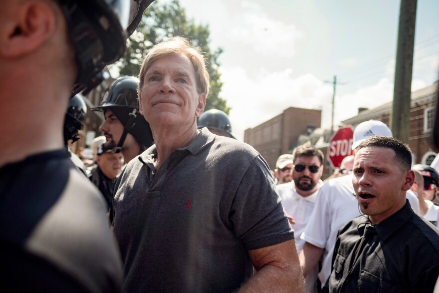 David Duke (center) participates in a rally where a crowd of white nationalists is met by a group of counterprotesters in Charlottesville, Va., on Saturday.