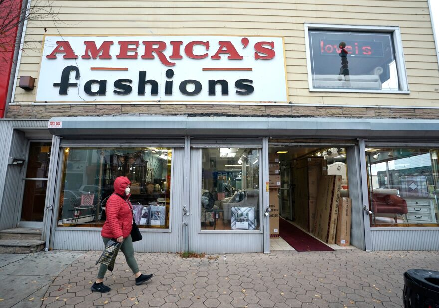 A person walks past a business in downtown Newark, New Jersey on Nov. 12, 2020. (Timoyhy A. Clary/AFP via Getty Images)