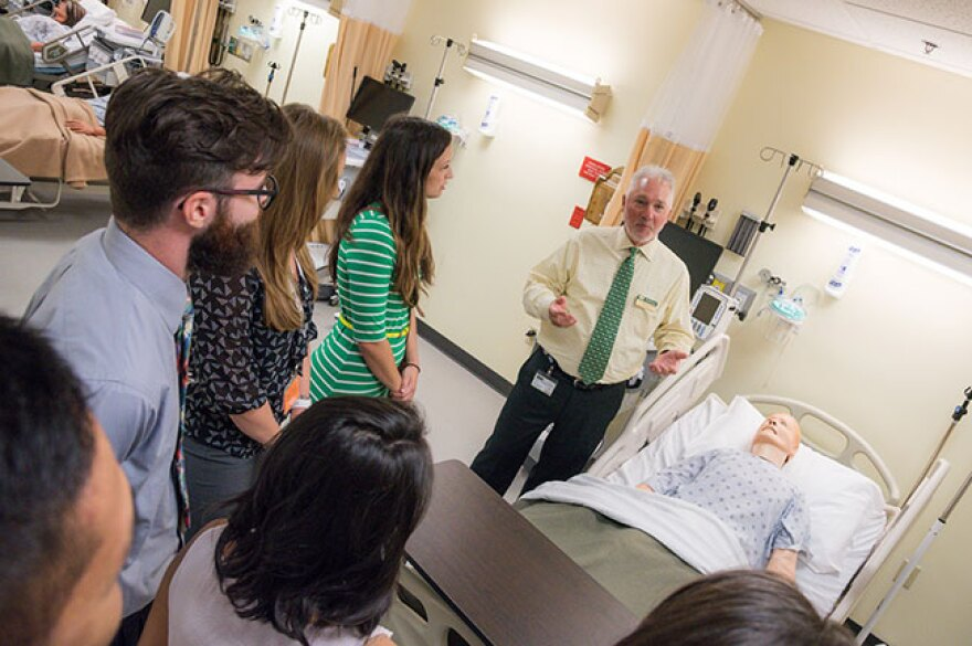 USF Health faculty member Larry Collins gives new PA students a tour of the simulation lab.