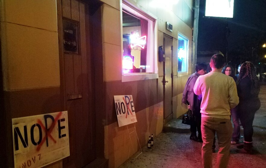Opponents of Proposition P gather outside Gina's Bar and Grill in the St. Louis Place neighborhood on Nov. 7, 2017 after the sales tax increase passed with 60 percent of the vote.