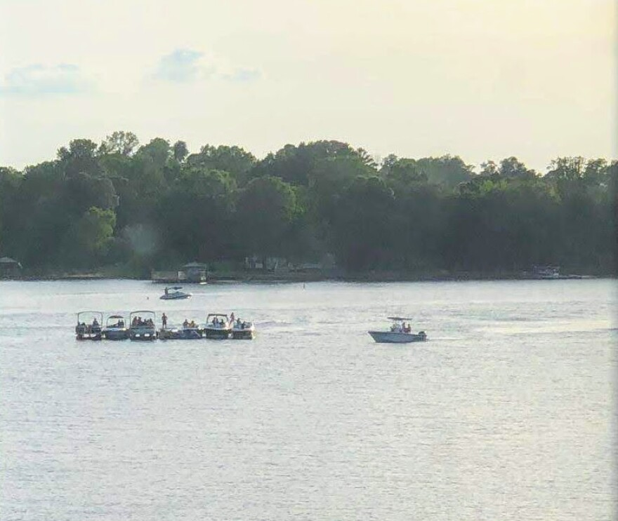 Boaters rafted up on Lake Norman in Cornelius last weekend. State officials say tying boats together is not permitted under the statewide COVID-19 rules.