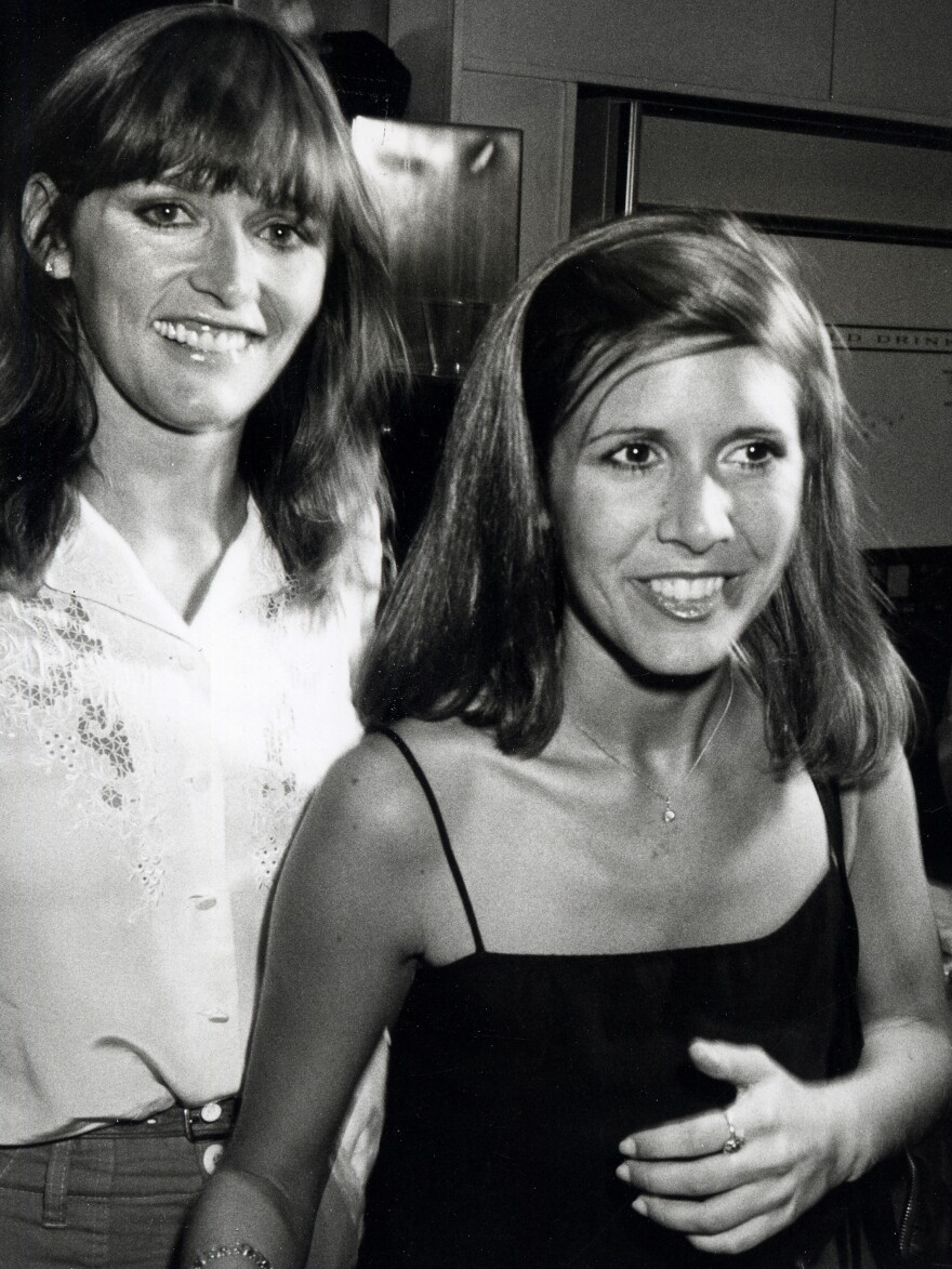 Kidder is seen here with Carrie Fisher, as the two attended a fundraiser in 1980 at the Empire State Building in New York City. Fisher died in December 2016.