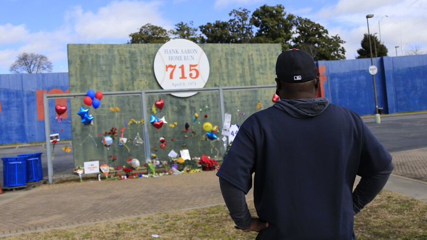 Fans pay their respects to Hank Aaron at the 715 Wall — site of Aaron's historic home run on the former grounds of Fulton County Stadium, the previous home of the Atlanta Braves.