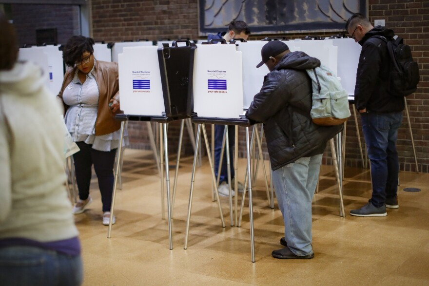 Voters cast their ballots at the Cincinnati Public Library's polling station, Tuesday, Nov. 5, 2019, in Cincinnati.