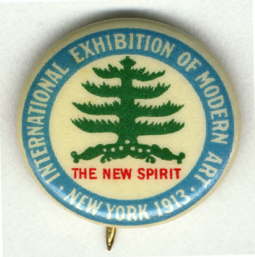 A pin from the 1913 International Exhibition of Modern Art in New York City.