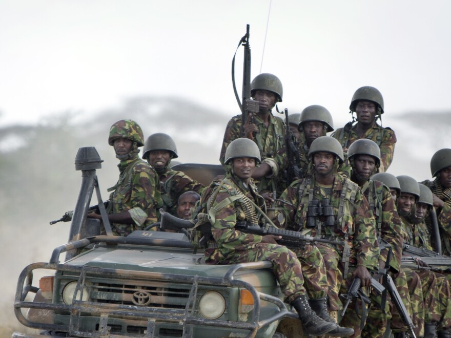 Kenyan army soldiers ride in a vehicle at their base in 2012. On Saturday, authorities in Kenya blamed Somali militant group al-Shabab for a blast that reportedly left 10 police officers dead.