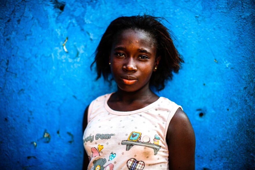 """""""Yes, I listen to that,"""" says 13-year-old Blessing Famata Johns. """"I listen to them telling children how to take exercise in the morning, how to relax and wake up and be strong. I listened to it once""""."""