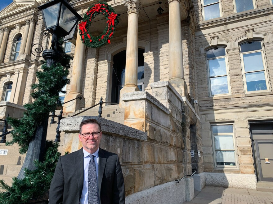 "Kevin Flanagan, chief assistant criminal prosecutor of Belmont County, stands outside the Belmont County Courthouse, in St. Clairsville. ""We look like any other small town in America,"" Flanagan says. Drug-related cases now make up the bulk of his work."