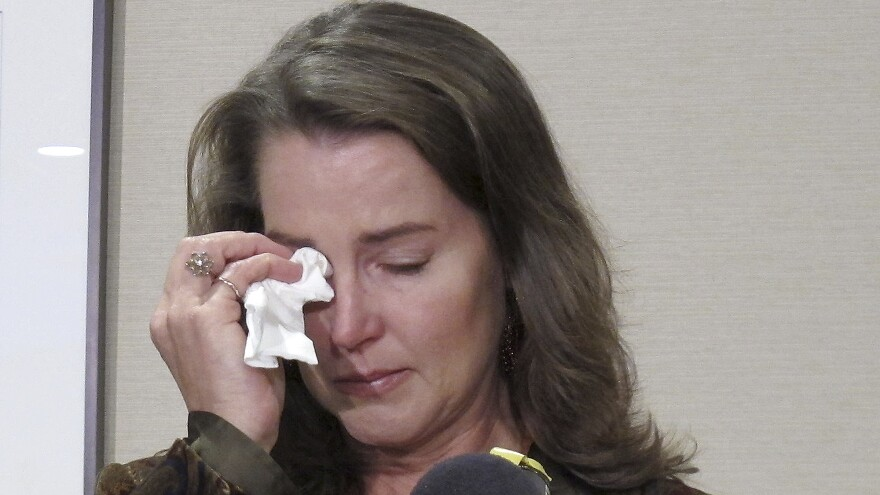 Cylvia Hayes, fiancee of Oregon Gov. John Kitzhaber, cries as she speaks at a news conference in Portland, Ore., on Thursday. Hayes admitted she violated the law when in 1997 she married an immigrant seeking to retain residency in the United States.