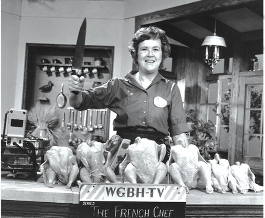 """Julia Child poses with """"the chicken sisters"""" before an episode of <em>The French Chef</em> in which she teaches us how to roast a bird."""