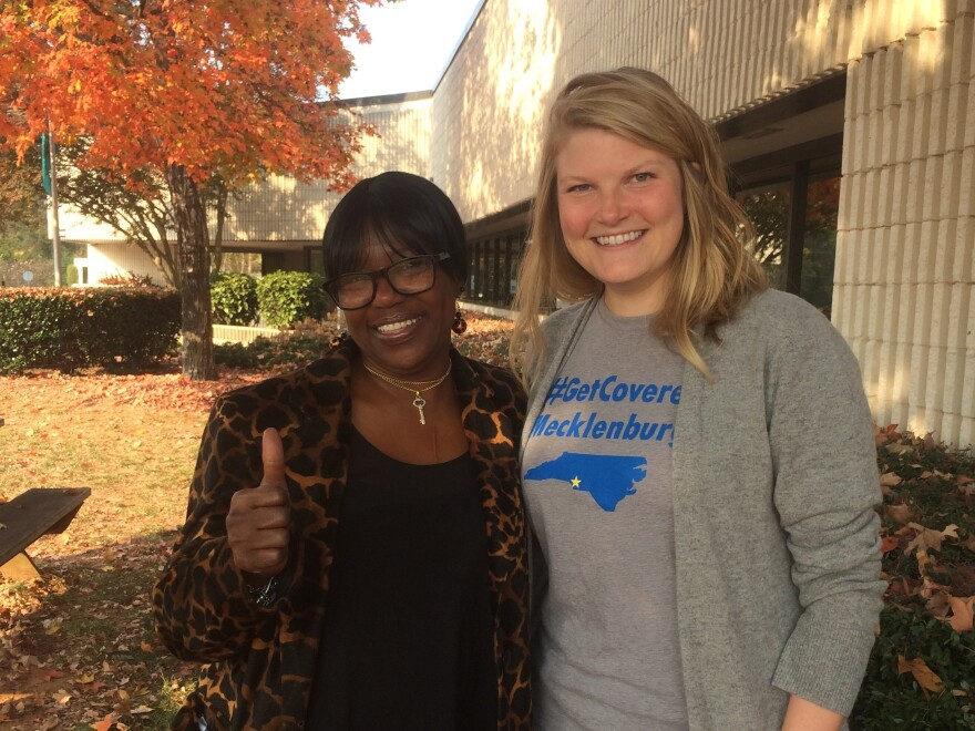 Darlene Hawes (left) and her enrollment counselor, Julieanne Taylor, outside the Mecklenburg County Health Department in Charlotte, N.C.