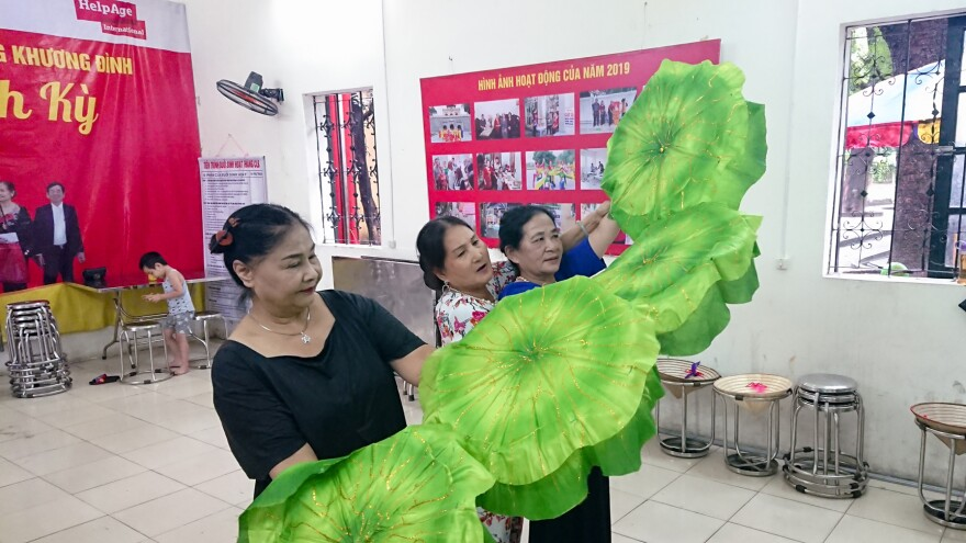Members of the club practice a traditional Vietnamese dance to perform for the upcoming International Day of Older Persons on Oct. 1.