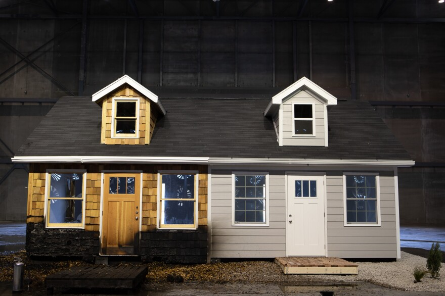 A test house hit by blown embers at a research facility run by the Insurance Institute for Business & Home Safety in South Carolina last spring. Half of the test home has cedar siding and other common combustible building materials. The other half has common fire-resistant materials such as cement siding.
