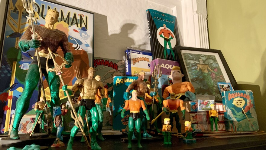 The author's collection of aqua-memorabilia. (Not pictured: The author's many, many Aquaman t-shirts. And the Aquaman tattoo on the authorial left deltoid.)