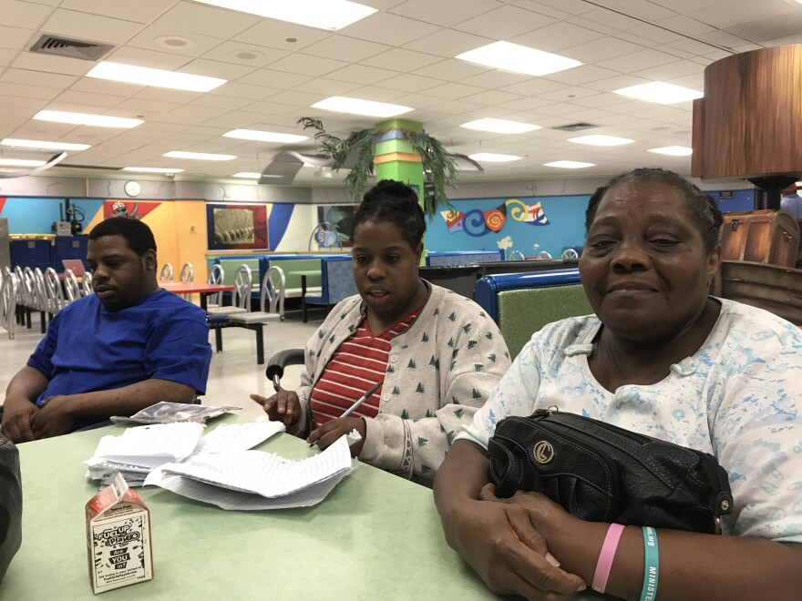 Gloria Guity, right, evacuated to Miami Edison Senior High School with her children Nelly and José during Hurricane Irma. Nelly and José have cerebral palsy, and for the three nights at the shelter, Guity, 76, was their only caretaker.