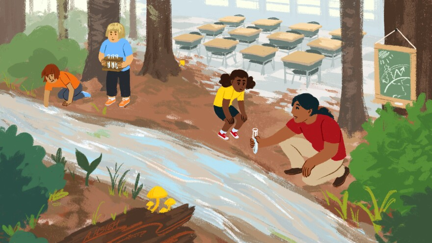In a classroom by a river, a teacher collects water samples with her class.