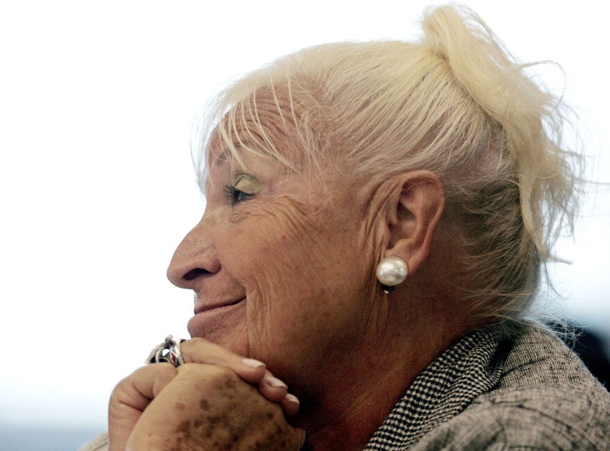 Misha Defonseca sits during proceedings at Massachusetts' Middlesex Superior Court in 2008. Defonseca, the author of a fabricated Holocaust memoir, has been ordered to pay back $22.5 million to her publisher.