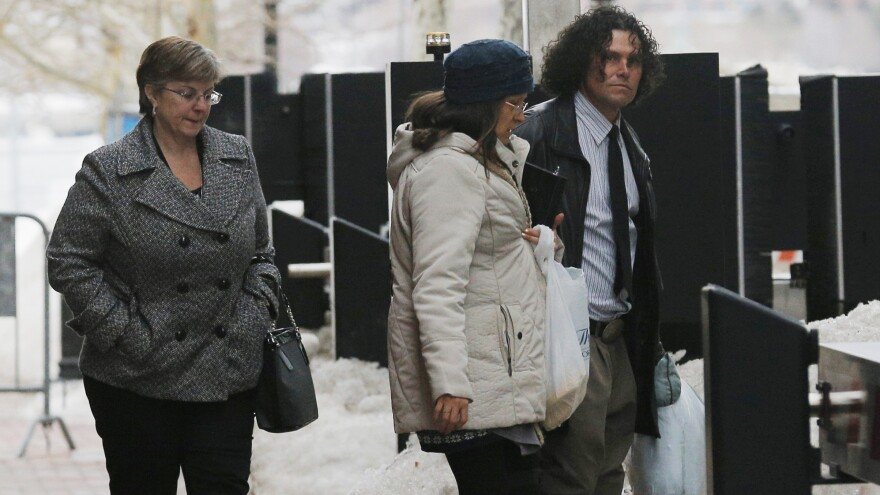 Boston Marathon bombing survivor Karen Brassard (left) and bombing witness Carlos Arredondo (right) leave a federal courthouse last week during the trial of accused bomber Dzhokhar Tsarnaev in Boston.