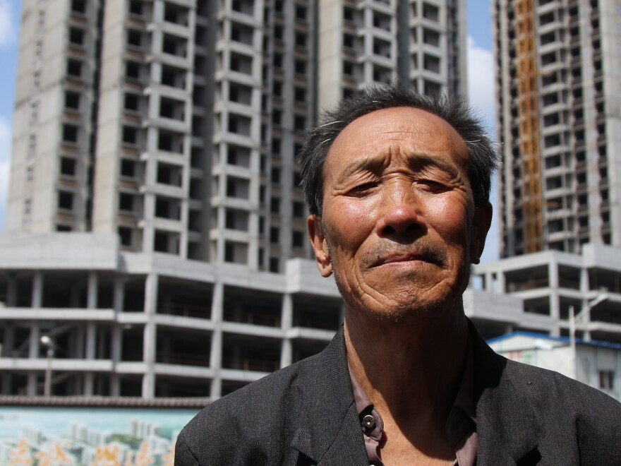 The home of farmer Liu Yihu, 63, was among thousands destroyed to make way for a new business and financial district that was shelved after the mayor was fired for corruption and the city ran out of money. The government says it will house some of the farmers in apartments, but Liu is skeptical.