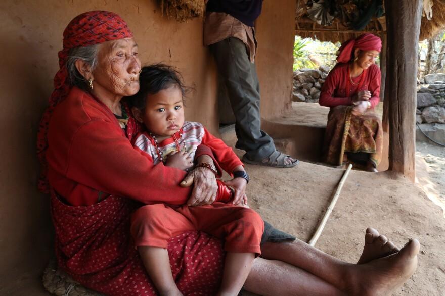 Manisara holds her granddaughter.