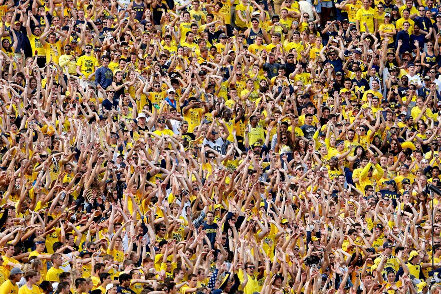 Michigan Wolverines fans do the wave in support of their team as it faces the Brigham Young Cougars at Michigan Stadium on Sept. 26, 2015, in Ann Arbor, Mich.