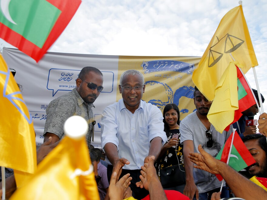 In a surprise victory, Ibrahim Mohamed Solih, center, ousted the president of the Maldives. On Monday, he celebrated with supporters in the capital, Malé.