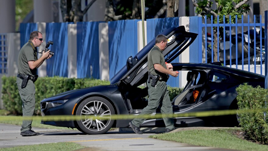 A BMW sits idle after reports of a shooting in Deerfield Beach involving the rapper XXXTentacion on Monday, June 18, 2018.