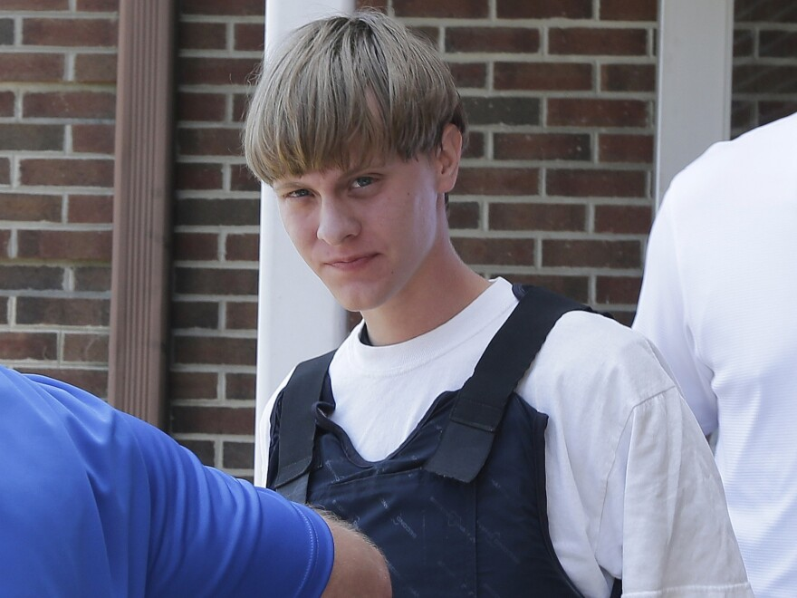 Dylann Roof is escorted from the Shelby Police Department in Shelby, N.C., on June 18, 2015.