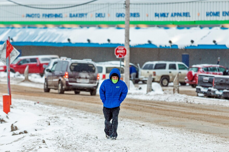A man wears a mask as the territory of Nunavut enters a two week mandatory restriction period in Iqaluit, Nunavut, Canada, on Wednesday. More than 80 COVID-19 cases have been identified this month in Nunavut, where around 39,000 people, predominantly Inuit, live in communities scattered across the territory.