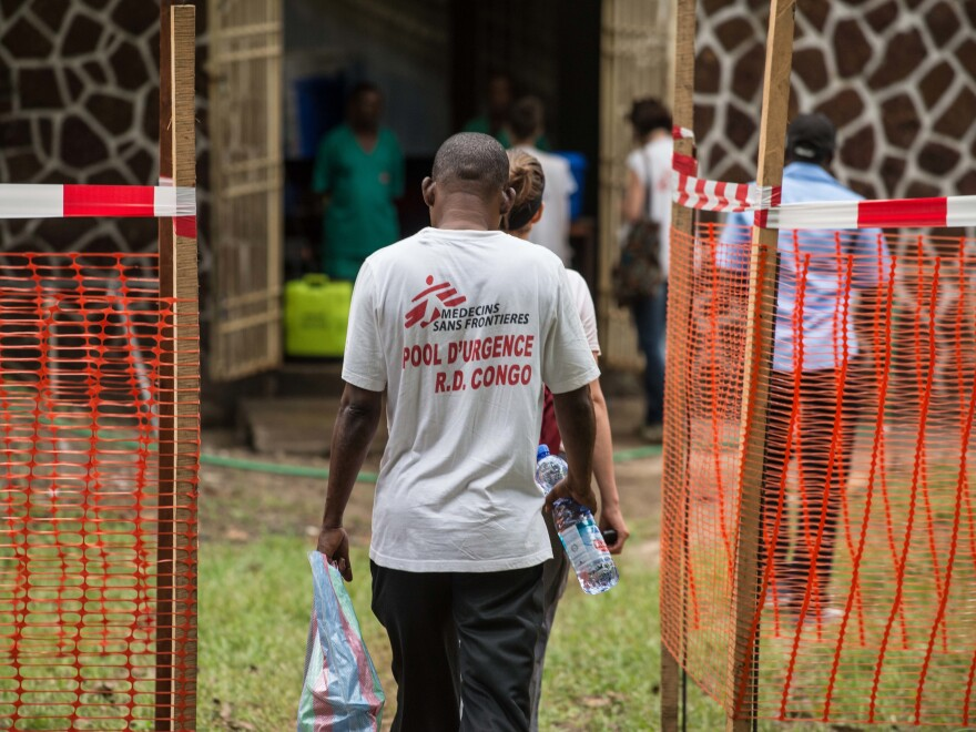 Doctors Without Borders staff enter an Ebola security zone at the entrance of the Wangata Reference Hospital in Mbandaka, in the Democratic Republic of the Congo.
