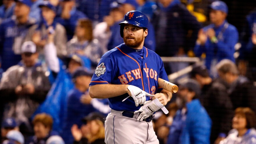 Daniel Murphy of the New York Mets reacts after striking out in the first inning during Game 1 of the World Series at Kauffman Stadium in Kansas City.