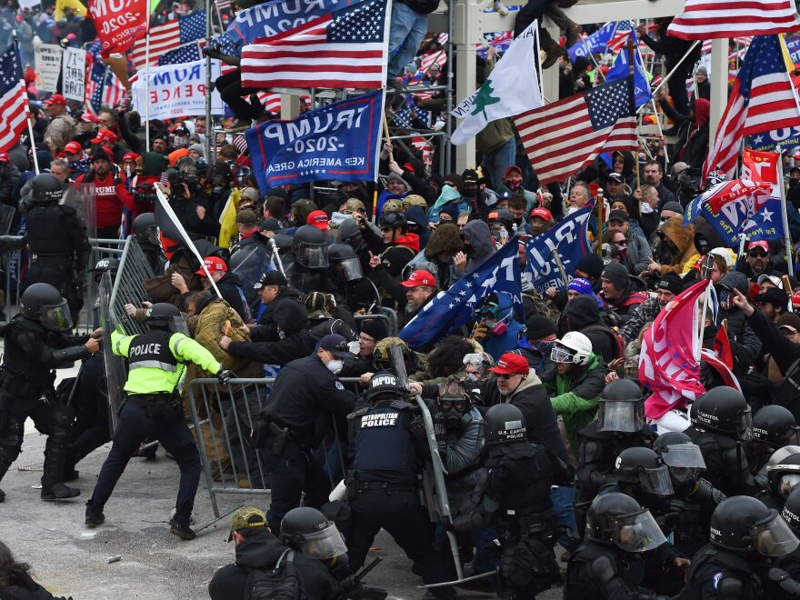 Trump supporters clash with police and security forces as they push down barricades to storm the U.S. Capitol on Jan. 6.